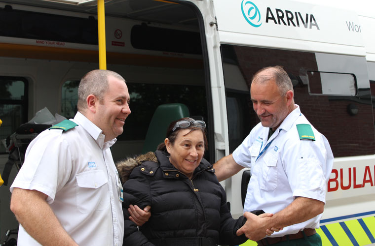 Staff helping patient